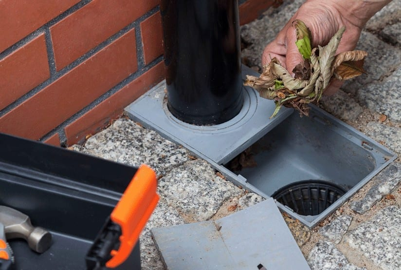 What causes blocked drains?